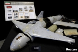 FILE - Remains of Iranian drones provided by the Pentagon are on display before U.S. Ambassador to the United Nations Nikki Haley briefs the media on highlights of the U.N.'s 2231 Implementation Report at Joint Base Anacostia-Bolling in Washington, Dec. 14, 2017.