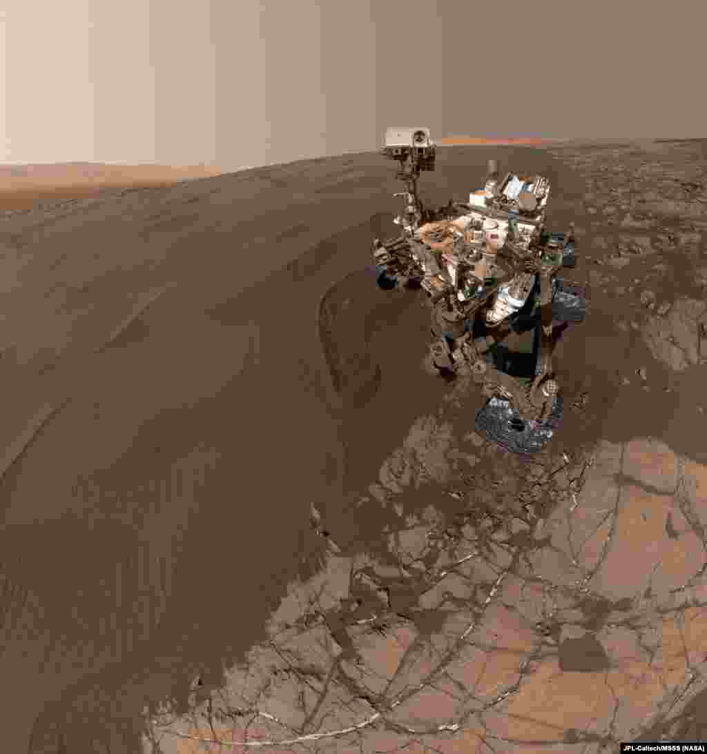 "This self-portrait of NASA's Curiosity Mars rover shows the vehicle at ""Namib Dune,"" where the rover's activities included scuffing into the dune with a wheel and scooping samples of sand for laboratory analysis."