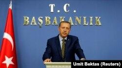 Revize edilmiş kabinesini açıklayan Başbakan Erdoğan