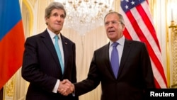 FILE - U.S. Secretary of State John Kerry, left, shakes hands with Russian Foreign Minister Sergei Lavrov before their meeting in Paris last March; the two will confer again next week in Geneva.