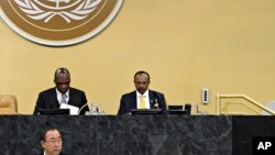 Under Secretary-General Tegegnework Gettu (right) and John Ashe, (left) the president of the 68th Session of the UN General Assembly, listen to Secretary-General Ban Ki-Moon's address on January 28, 2013.