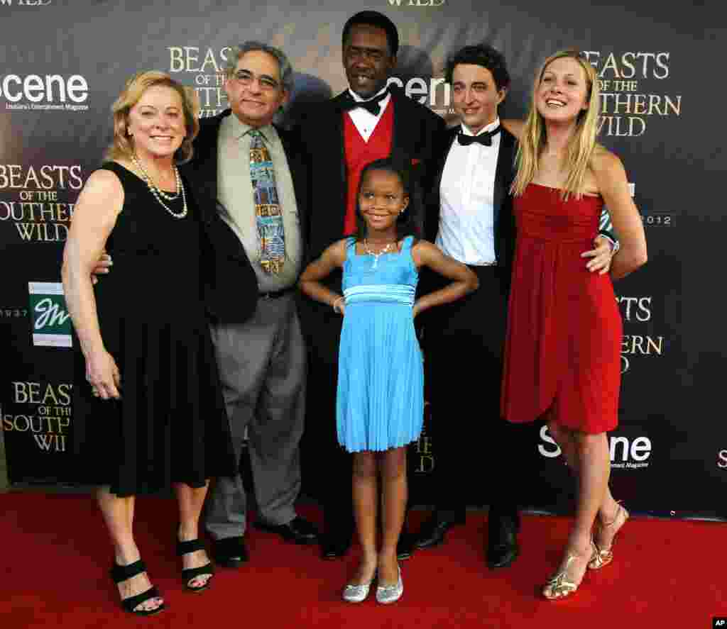 "Cast members and Fox Searchlight executives pose on the red carpet at the movie premiere of ""Beasts Of The Southern Wild"" at the Joy Theater in New Orleans, Louisiana, June 25, 2012."
