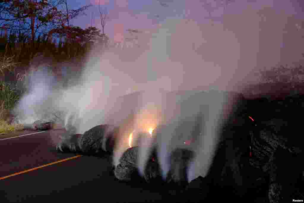 Volcanic gases rise from the Kilauea lava flow that crossed Pohoiki Road near Highway 132, near Pahoa, Hawaii, May 28, 2018.
