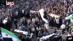 An image taken from a video uploaded on YouTube on April 5, 2012, shows the funeral of five Syrian men in Duma near the capital, Damascus.