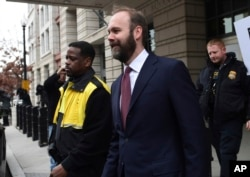 FILE - Rick Gates leaves federal court in Washington, Feb. 23, 2018.