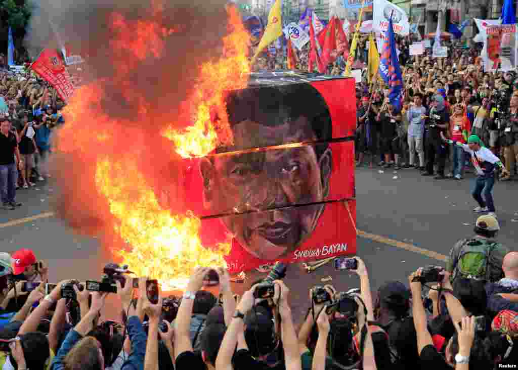 Protesters burn an effigy with a face of President Rodrigo Duterte during a National Day of Protest outside the presidential palace in metro Manila, Philippines.