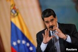 Venezuela's President Nicolas Maduro gestures as he speaks during a news conference in Caracas, Venezuela, Sept. 30, 2019.