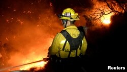 Firefighters battle the Thomas fire in the hills and canyons outside Montecito, California, Dec. 16, 2017.