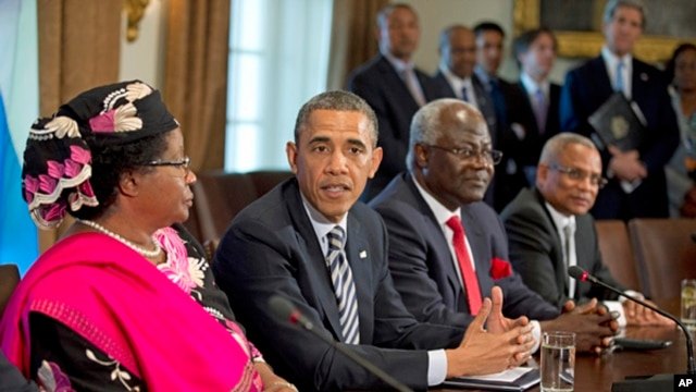President Barack Obama in the Cabinet Room of the White House after a meeting with, from left, Malawi President Joyce Banda; Sierra Leone President Ernest Bai Koroma; and Cape Verde Prime Minister José Maria Pereira Neves, March 28, 2013.