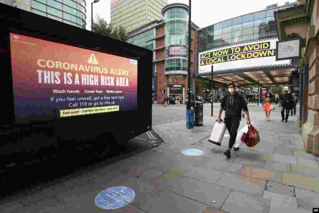 "Public information messages in central Manchester England, are hung after British Prime Minister Boris Johnson set out new restrictions to last ""perhaps six months"" to slow the renewed spread of coronavirus."