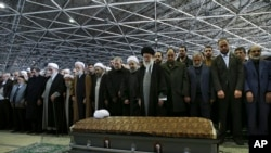 In this picture released by an official website of the office of the Iranian supreme leader, Supreme Leader Ayatollah Ali Khamenei, foreground center, leads a prayer over the casket of former President Akbar Hashemi Rafsanjani at the Tehran University cam