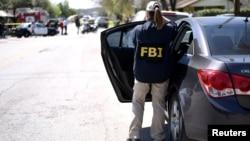 Un agent du FBI sur les lieux d'une explosion au Texas, le 12 mars 2018.