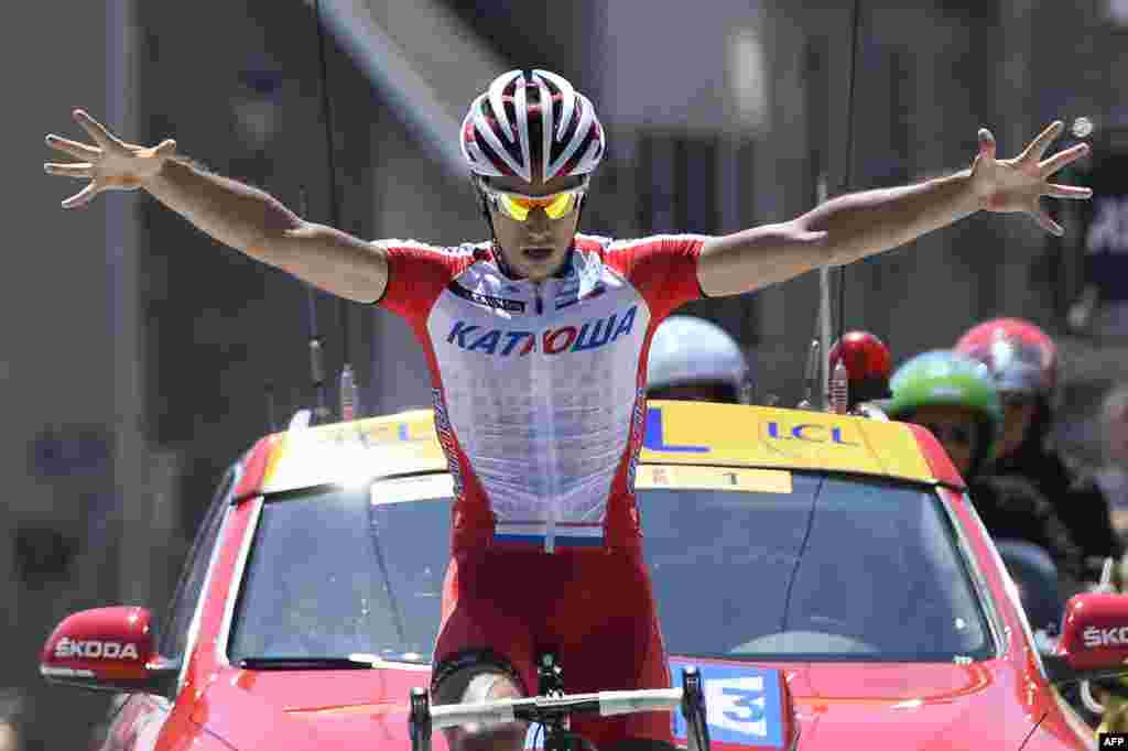Slovenian cyclist Simon Spilak celebrates at the finish line after winning the fifth stage (Sisteron - La Mure) of the 66th Dauphine Criterium cycling race in La Mure, France.