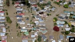 The streets of the North Island town of Edgecumbe in New Zealand, flooded, April 6, 2017, after heavy rain from the remnants of Cyclone Debbie. About 2,000 residents were rescued.
