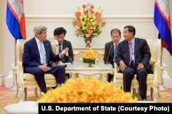 FILE - U.S. Secretary of State John Kerry, left, addresses Cambodian Prime Minister Hun Sen at the outset of a bilateral meeting at the Peace Palace in Phnom Penh, Cambodia, Jan. 26, 2016.