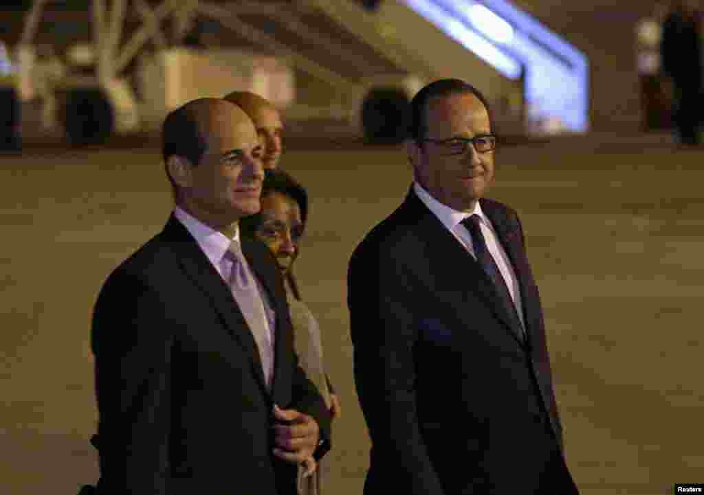French President Francois Hollande (right) walks next to Cuba's Deputy Foreign Minister Rogelio Sierra at Jose Marti International Airport, Havana, May 10, 2015.