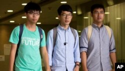 Three Hong Kong student protest leaders, from left, Joshua Wong, Nathan Law and Alex Chow walk out from a magistrate's court in Hong Kong, Monday, Aug. 15, 2016.