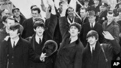 Los Beatles al llegar a Estados Unidos en 1964.