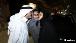 Hannan Iskandar is kissed by her parents, after she drove her car in her neighborhood, in Al Khobar, Saudi Arabia, June 24, 2018.