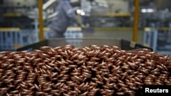 These copper tubes will be part of air conditioning units made by a company in Japan. Copper kills many germs on contact, making it a smart choice for ventilation systems. (REUTERS/Yuya Shino/March 2015)