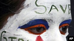 FILE - A girl's face is painted with a message decrying female feticide, as part of a face-painting competition in the northern Indian city of Chandigarh.