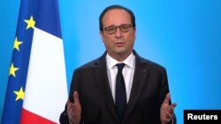 French President Francois Hollande, seen in this picture taken from French TV, makes a televised address from the Elysee Palace in Paris, Dec. 1, 2016.