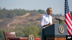 FILE - President Barack Obama speaks at Frank G. Bonelli Regional Park in San Dimas, Calif., as he designated the nearly 350,000 acres within the San Gabriel Mountains northeast of Los Angeles a national monument, Oct. 20, 2014. Obama is granting national