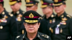 FILE - Thai new Prime Minister Prayuth Chan–ocha arrives to attend an establishment anniversary of the 21st Infantry Regiment, Queen's Guard in Chonburi Province ,Thailand, Aug. 21, 2014.