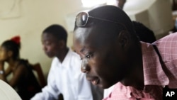 FILE - Momulu Norman, 22, teaches at a computer school in Monrovia, Liberia.