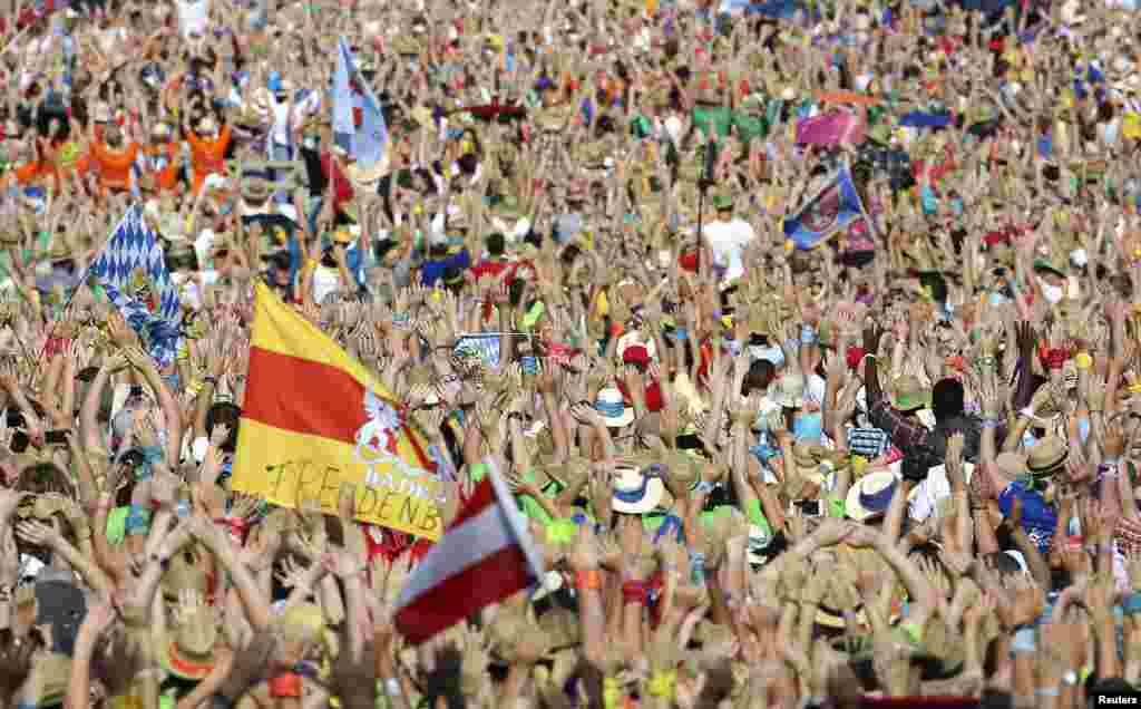 The faithful celebrate before a meeting with Pope Francis in St Peter's square at the Vatican.