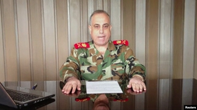 General Abdelaziz Jassim al-Shalal, the head of Syria's military police, speaks in a video uploaded on a social media website, December 26, 2012.