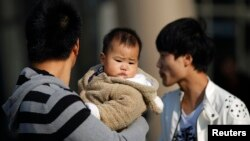 Over the years, China has relaxed its family planning laws. The country now allows millions of families to have two children. But letting single women have children or even freeze their own eggs is a different story. (Reuters file photo 2013)