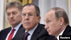 FILE - Russian President Vladimir Putin, Foreign Minister Sergei Lavrov and Kremlin spokesman Dmitry Peskov (R-L) attend a meeting at the Kremlin in Moscow, Russia, March 24, 2016.