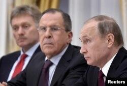 Russian President Vladimir Putin, FM Sergei Lavrov and Kremlin spokesman Dmitry Peskov (R-L) meet with Sheikh Mohammed bin Zayed al-Nahyan (not seen), Crown Prince of Abu Dhabi and UAE's deputy commander-in-chief of the armed