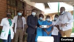Members of the COVID Response Private Citizens Initiative donate medical equipment at a public hospital in Malawi. (COVID Response Private Citizens Initiative)