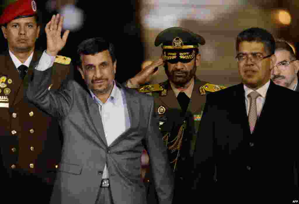 Iran's President Mahmoud Ahmadinejad waves upon his arrival at the international airport in Maiquetia, Venezuela, on January 8, 2012, at the start of his Latin American tour. (AP)