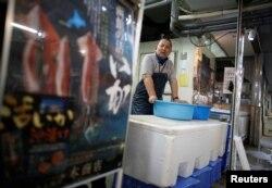 Atsushi Kobayashi, a live squid trader, stands at his shop in Ota Wholesale Market in Tokyo, Japan, July 23, 2018.