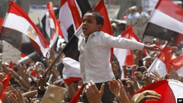 A young Egyptian protester shouts slogans at Tahrir Square in Cairo, April 1, 2011