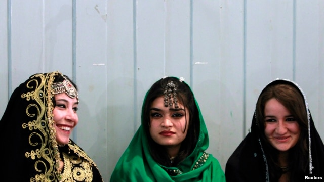 FILE - Young Afghan women attend teachers' graduation ceremony, Kabul, March 30, 2011.