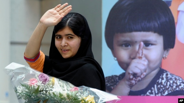 Malala Yousafzai, the 16-year-old girl from Pakistan who was shot in the head by the Taliban last October for advocating education for girls, waves as she leaves the stage after speaking about her fight for girls' education on the International Day of the