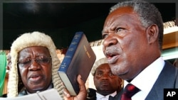 Zambia's new President Michael Sata, right, takes the oath of office on the steps of the supreme court in Lusaka, Zambia, Friday Sept. 23, 2011.