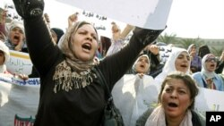 Women shout anti-Mubarak slogans as they demonstrate in the main square in downtown Cairo, February 1, 2011.