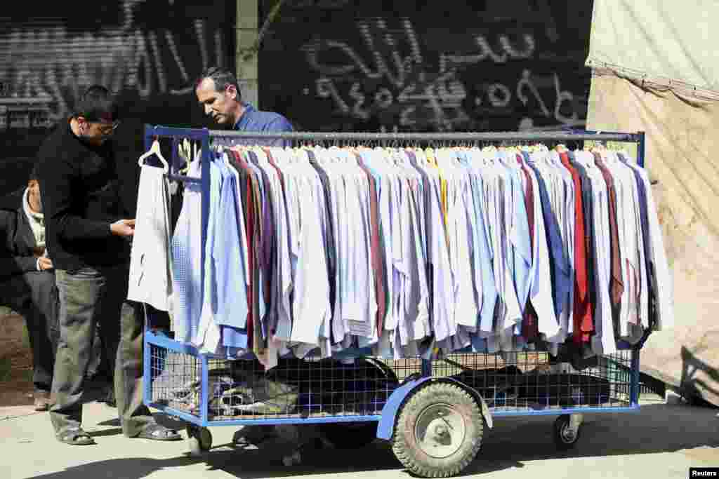 A man sells clothes in Aleppo March 24, 2013.