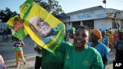 Supporter of the ruling CCM party in Tanzania celebrate after the party's presidential candidate, John Pombe Magufuli was declared a winner, in Dar es Salaam, Tanzania, Oct. 29, 2015.