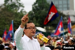 FILE - Sam Rainsy (C), leader of the opposition Cambodia National Rescue Party is seen speaking at a protest in central Phnom Penh.