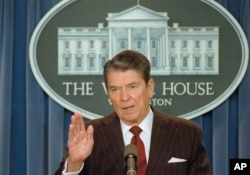 "In this Nov. 25, 1986 file photo, then President Ronald Reagan tells reporters ""I'm not taking any more questions"" as questions about the Iran-Contra scandal mounted."