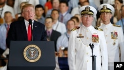 President Donald Trump, left, puts the USS Gerald Ford into commission as Navy commanders look on, at Naval Station Norfolk, in Norfolk, Virginia, July 22, 2017.