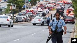 A Metropolitan Police Department officer walks near the Washington Navy Yard, Sept. 16, 2013.
