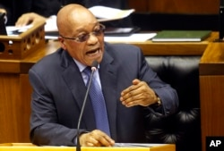 FILE - South African President Jacob Zuma answers questions in parliament in Cape Town, South Africa, March 17, 2016.