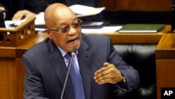 FILE - South African President Jacob Zuma answers questions in parliament in Cape Town, South Africa, March 17, 2016. Zuma has been ordered to pay $500,000 to reimburse the treasury for using public funds to pay for upgrades at his home.